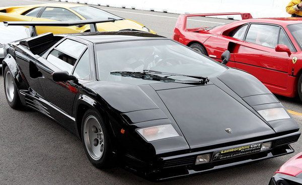 I had a replica in black with bronze rims. Never had a better toy to play with as a child..... One beautiful machine | Lamborghini Countach  1973-1990