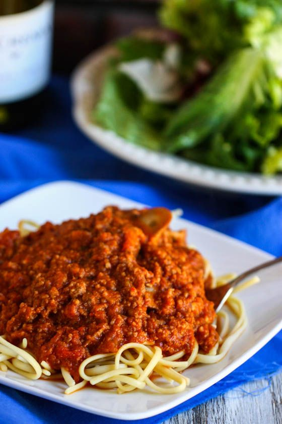 I love my spaghetti sauce, but this one looks worth trying! Secret is cheese IN the sauce, WINE, and a mixture of ground turkey/beef and sausage. It's gotta be good.