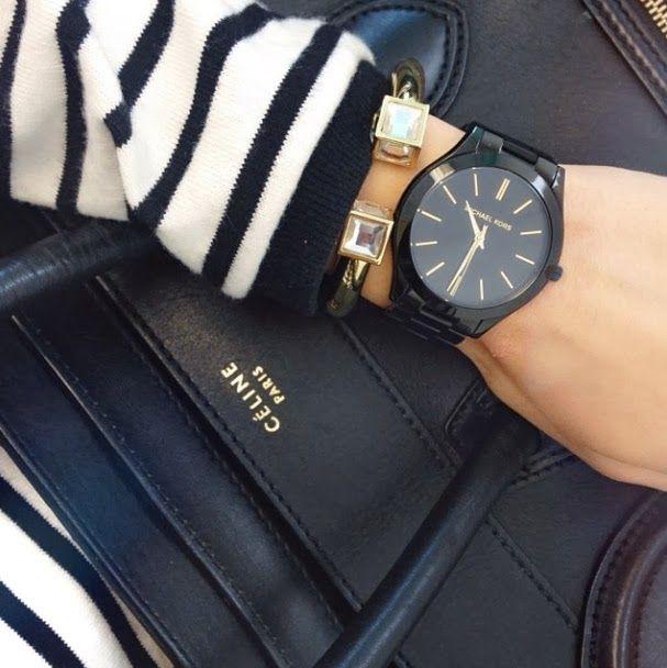 black michael kors watch // black céline bag