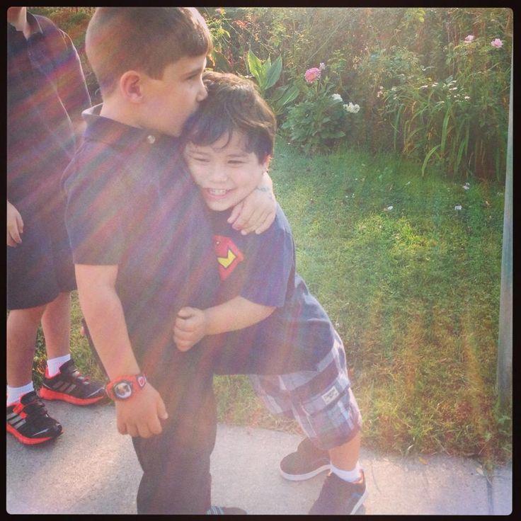 Brother hug before Jullian get's on the school bus!!!!
