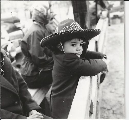 In an undated photo, future superstar Ronstadt watches a rodeo near her music-filled childhood home in Tucson. Photo: Gilbert Ronstadt