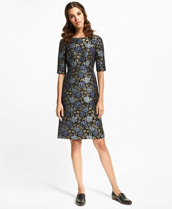 """The Brooks Brothers Women's Collection by Creative Director Zac Posen<br><br>Shimmering metallic floral jacquard lends this sophisticated sheath an elegantly dramatic air. This feminine silhouette is styled with a classic boatneck, elbow-length sleeves, waist-defining darts, an alluring V-back and a concealed back zip closure. It is fully lined for a flawless finish.<br><br>34½"""" center back length; 53% viscose, 41% polyester, 6% metallic fiber; dry-clean; made..."""