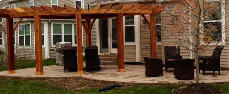 Custom Radial Pergola / Two color concrete / Saber cart grill / Family Leisure