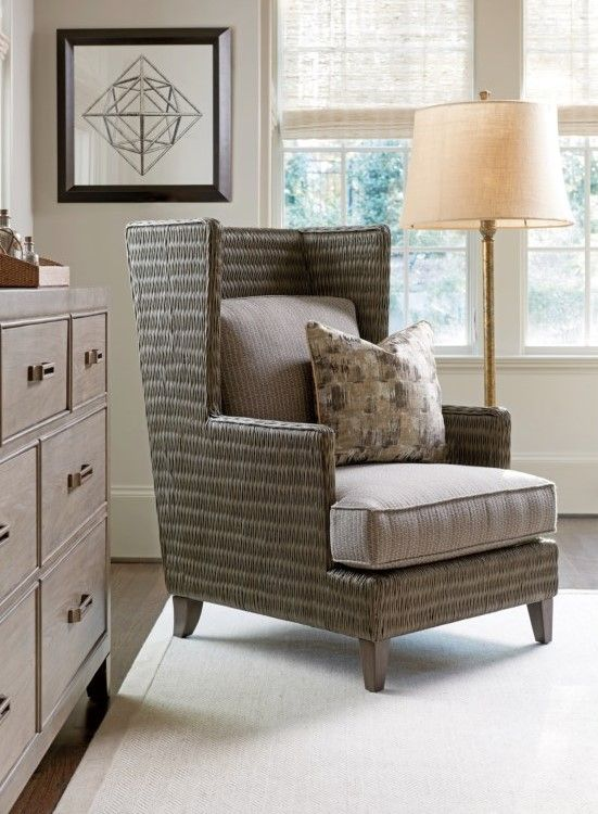 this updated wing chair makes a great statement with its accentuated shelter back and clean