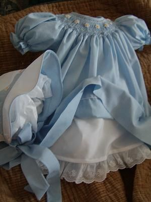 Very elegant smocked dress, and love the way the colors are reversed on the bonnet...Check out their site for ideas
