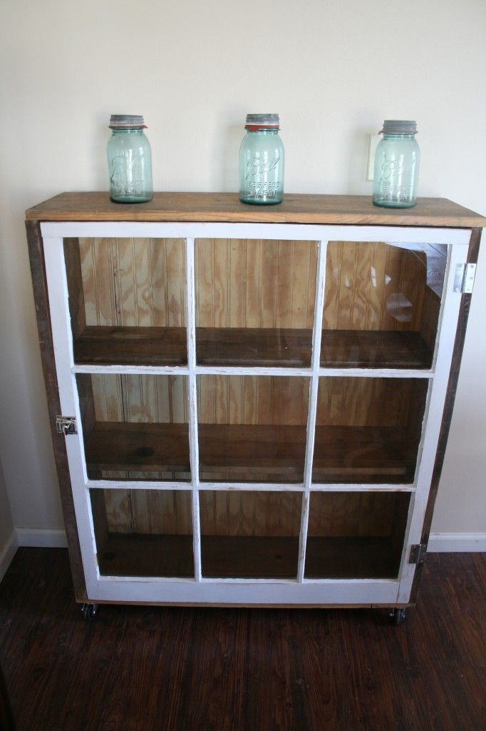 upcycled pane window onto front of cabinet to make glassed-in display cabinet - love this idea! how about smaller windows, mounted on the wall?