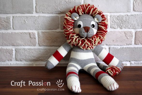 Sock Lion Tutorial.  Okay ... the socks are bought.  However, yarn is involved and he is flipping cute to boot.