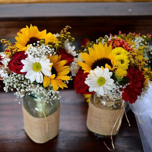 mason jars, burlap and fall colors! My wedding theme in a picture. Plus lace around the jars!