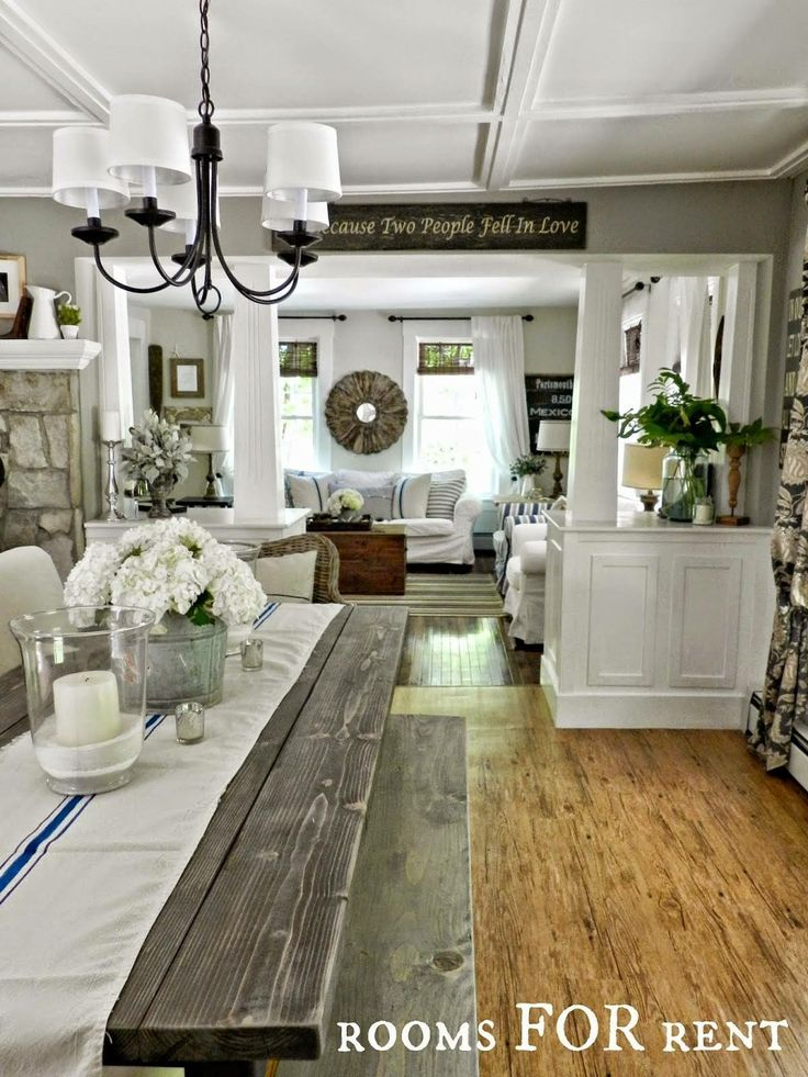 Old wooden picnic table for the dining room, wicker end chairs. Love all the white!