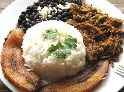 influenced by Venezuela the national dish of FRENCH GUINEA is pabellon, shredded beef, plantains, rice and beans