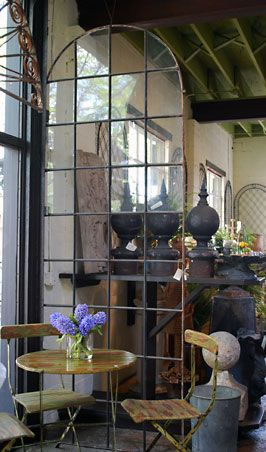 French Arched Conservatory Window..incredible <3 as are the bistro chairs & obelisks...