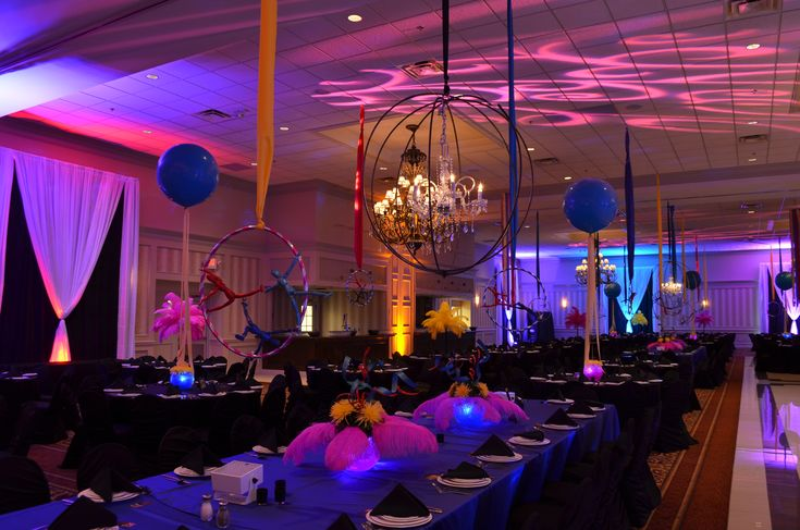 Love the color combinations of purple, orange and French blue with all the accented lighting. Also, the circle gobos on the ceiling add a spectacular ambiance