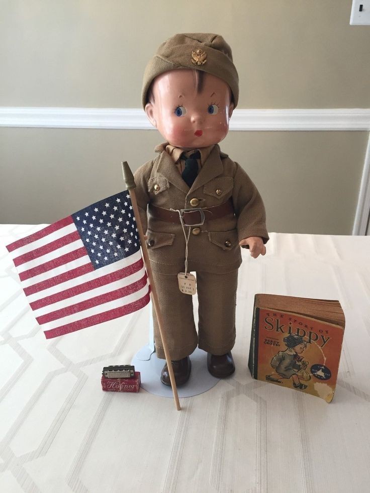 """This adorable 14"""" Composition Effanbee Skippy Soldier doll is in his original soldier uniform which consists of shirt, tie, jacket with faux brass buttons, belt, and topped off with his snappy cap with faux brass insignia of an eagle. 