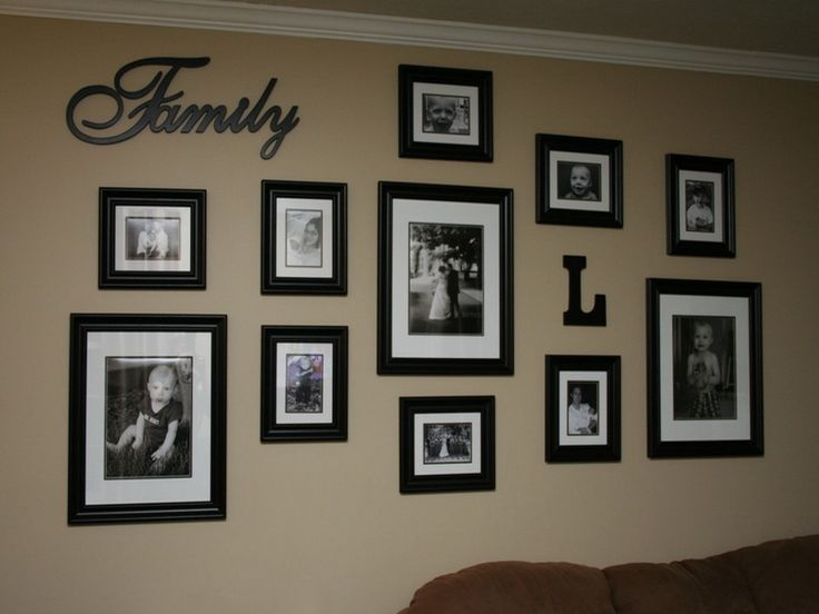 need to redo the family picture wall loving the individual frames and the letters also idea for school pictures - Picture Frame Design Ideas