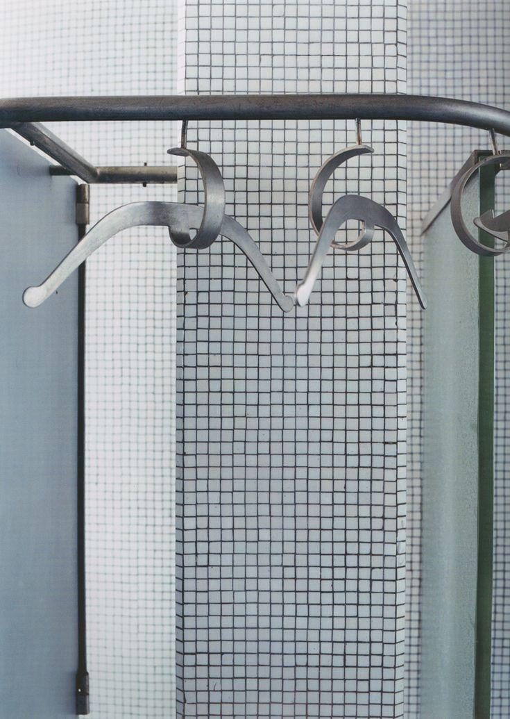 Mustache coat hangers in bathroom. Pierre Chareau. Maison de Verre. Paris.