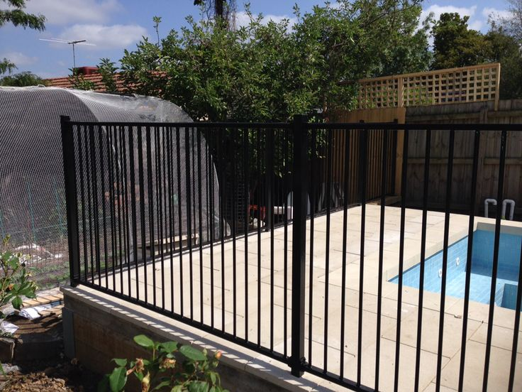 Pool fence and paving by FTProjects