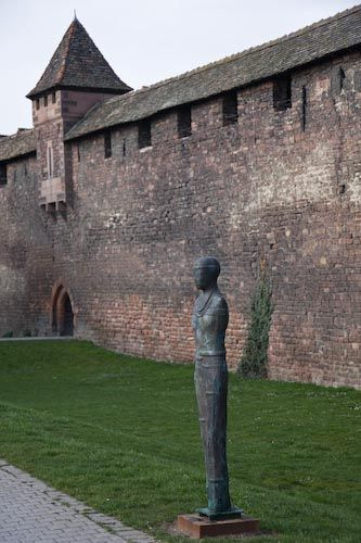 Pictures of Worms, Germany: Picture of Worms' medieval wall and a statue.