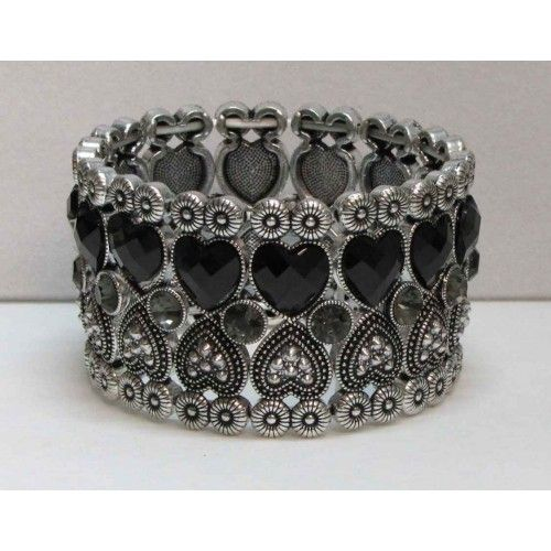 Bracelet élastique de couleur argent serti de pierre noires ou claires et de cristaux.  Aussi disponible en doré.