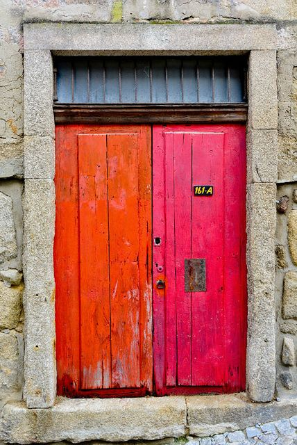 Porto, Portugal; not quite a barn painting but very similar to the color of our barn door...
