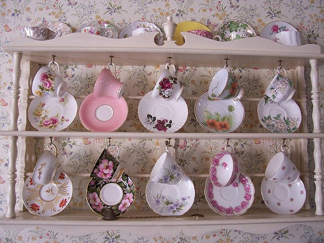 I really like this teacup and saucer display. It shows off both while being space efficient and at the same time cute.