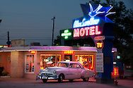 With a 1951 Pontiac Chieftain parked out front, the Blue Swallow Motel evokes the era of the post-war travel boom.  One of the longest continuously operated motels on Route 66, it remains profitable to this day.