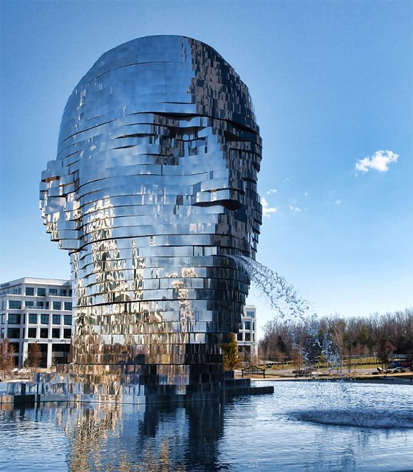 It stands 30 feet tall and weighs a staggering 14 tons. Awesome! It's situatedat the Whitehall Technology Park in Charlotte, NC. David Černýdesigned this sculpture, ismade from massive stainless steel layers that rotate 360° with each element out of syn and occasionally theyalign to form a gigantic head!