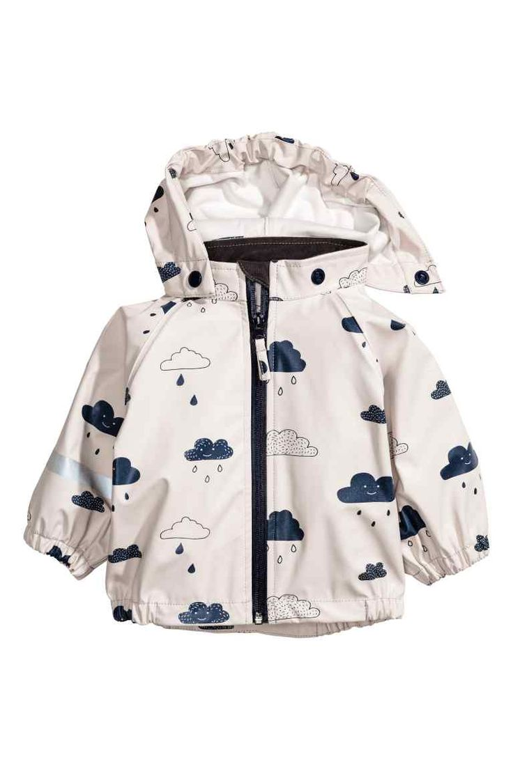 Waterproof jacket: Jacket in patterned, wind- and waterproof functional fabric with welded seams and a detachable hood that is elasticated at the front. Waterproof zip down the front and elastication at the cuffs and hem. Unlined. The jacket has a water-repellent coating without fluorocarbons.