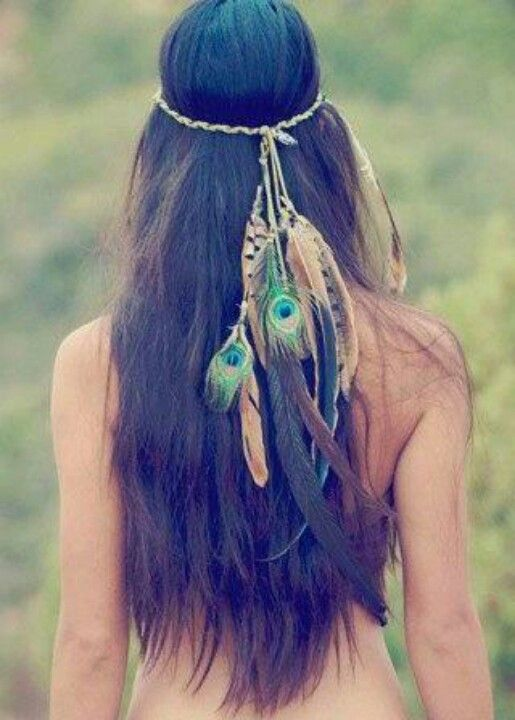 She wore feathers in her hair.