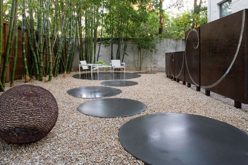 Concrete Landscaping, a little too minimilist for me but love the large round concrete pavers and NO lawn...