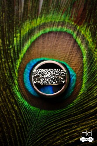 Peacock themed wedding; rings