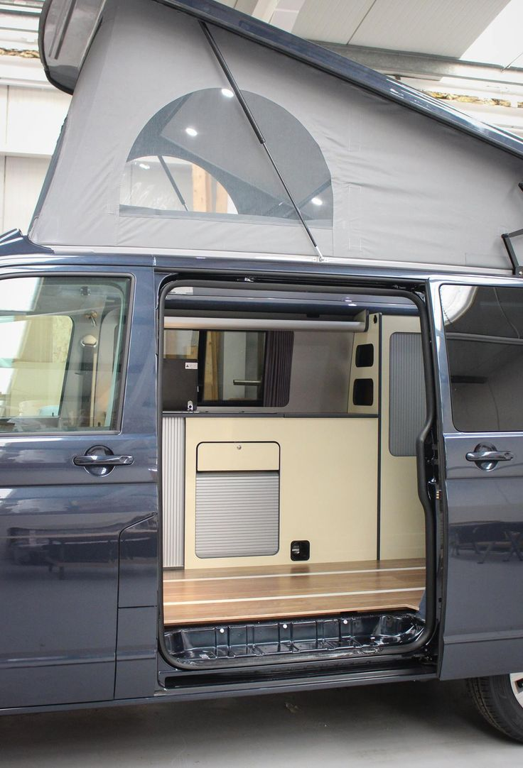 VW T6 Highline Campervan Conversion  SCA front elevating roof & fitted with the Reimo sliding bed/seat