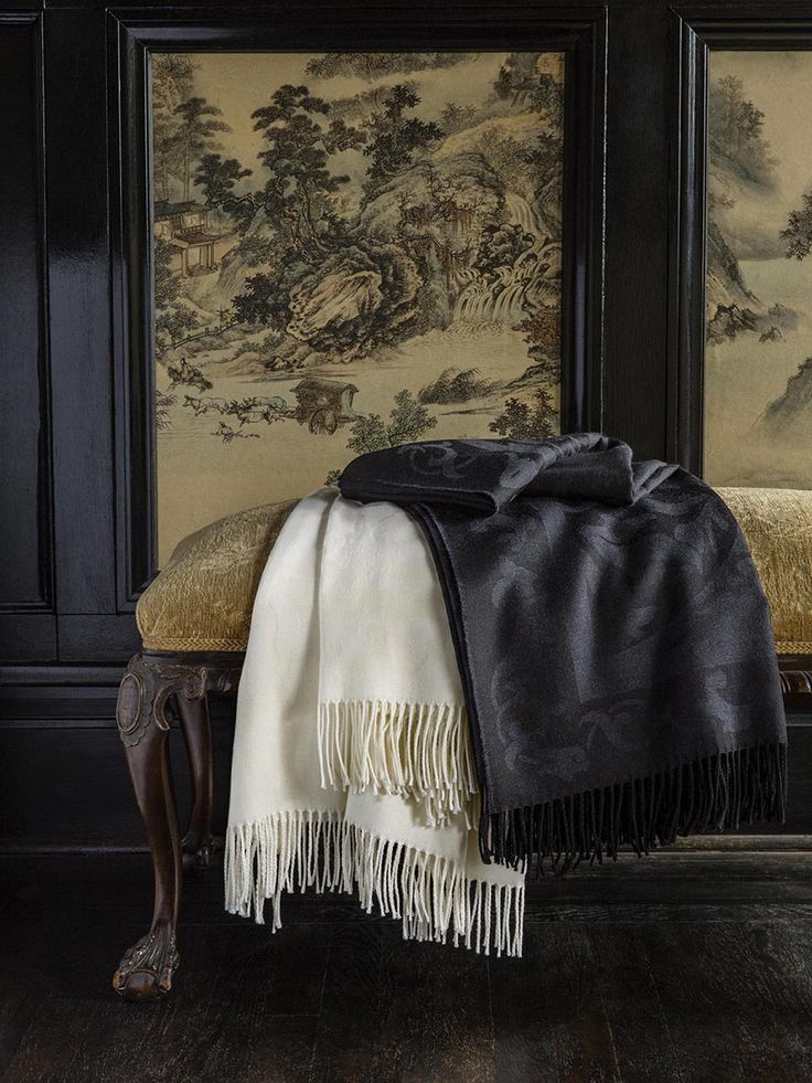 The luxurious Amaro throw is woven from blended wool and silk yarns, giving it a sublime, lightweight warmth, soft drape, and silken-smooth feel.