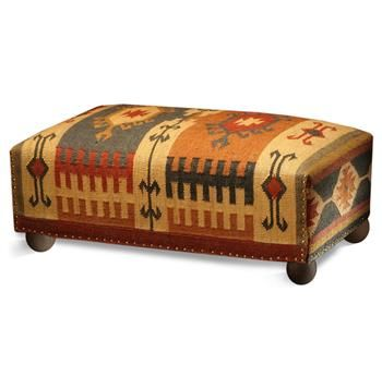 Global bazaar meets rustic sophistication in the rich tones of this classic ottoman's kilim wool finish.  Tacked edges and ball feet add extra interest.  Take a seat or put your feet up, and enjoy this classic piece!
