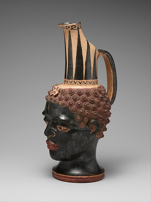 """Terracotta Vase in the Shape of an African Youth's Head.  Etruscan, 4th century BC  The Metropolitan Museum of Art      """"This vase combines the distinctive neck of the so-called Shape VII oinochoe with a naturalistic head of a young black African boy."""""""