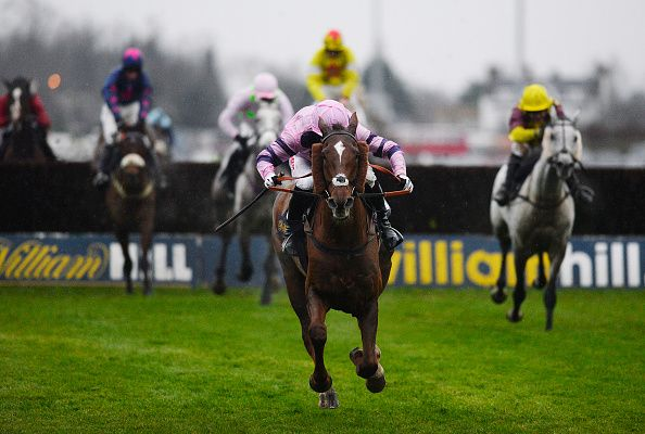 Noel Fehily riding Silviniaco Conti clears the last to win The William Hill King George VI Steeple Chase at Kempton Park racecourse on December 26, 2014 in Sunbury, England. (Photo by Alan Crowhurst/Getty Images)