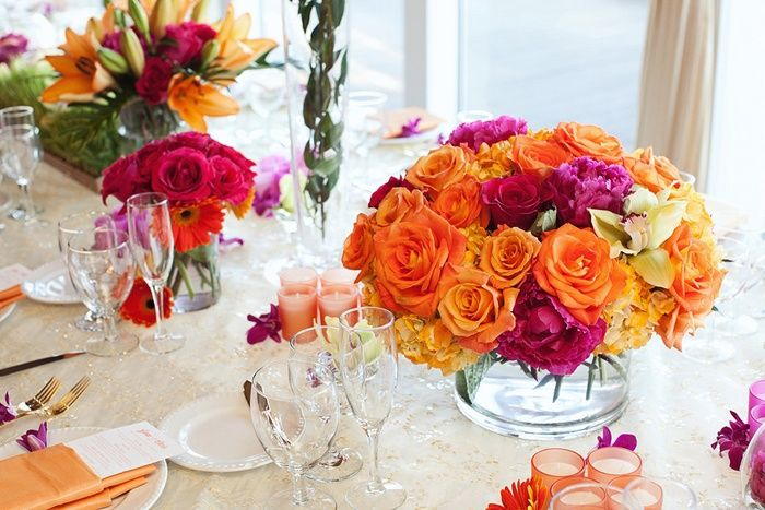 A low centerpiece is ideal for tables so that your guests can speak with one another without having a giant floral obstacle blocking their view. A tightly packed vase filled with bright flowers is a perfect example.