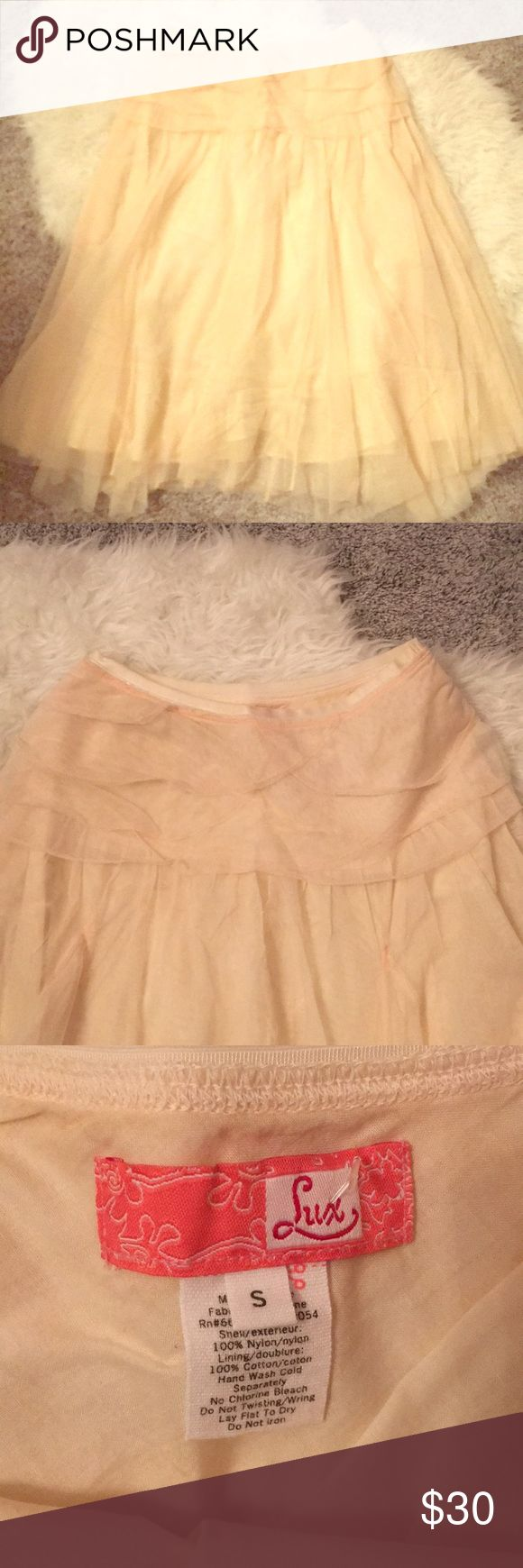 Gorgeous Lux Peach Skirt Gorgeous Lux Peach Skirt. EUC. Will need to be steamed due to wrinkles from storage. Beautiful tulip style detail at top with material.   🚫 from a pet and smoke free home ❌ no stains or tears  📬 next day shipping (unless next day is Sunday) Lux Skirts Midi