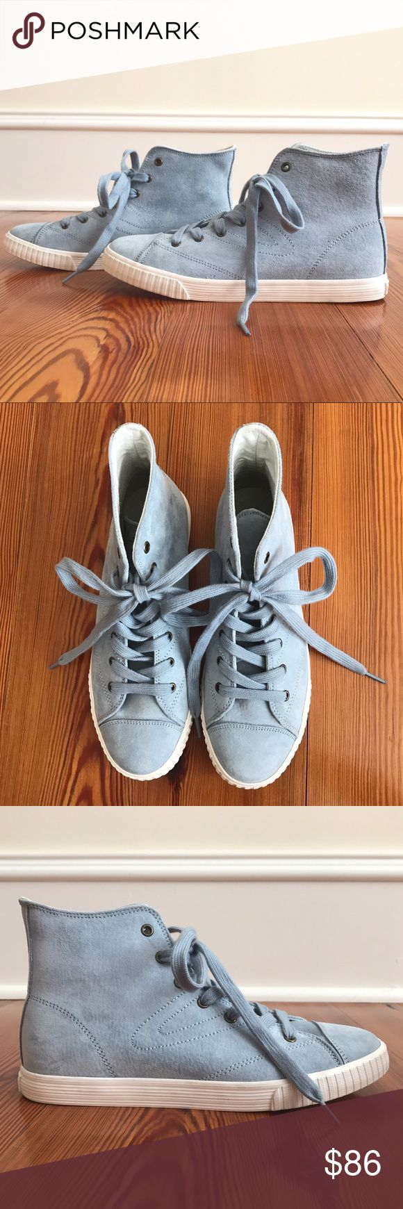 NEW NEVER WORN Blue Tretorn Hightops NEW NEVER WORN blue Tretorn hightops. These shoes are super cute and stylish in size women's US 8. They super comfortable and retro!! Tretorn Shoes