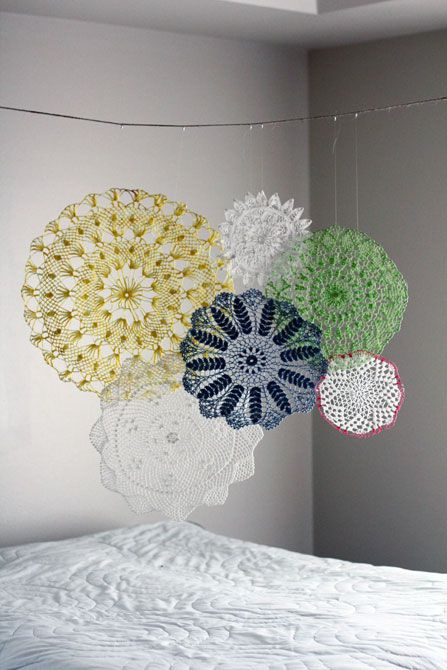 Doily garland, wall art or mobile.  So pretty!