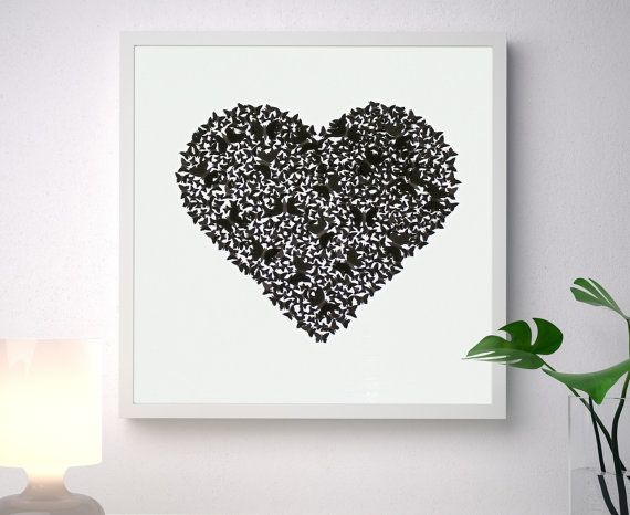 Unique handmade picture, made of more than 300 individually cut and placed 3D black art paper butterflies forming a classic heart shape, on a