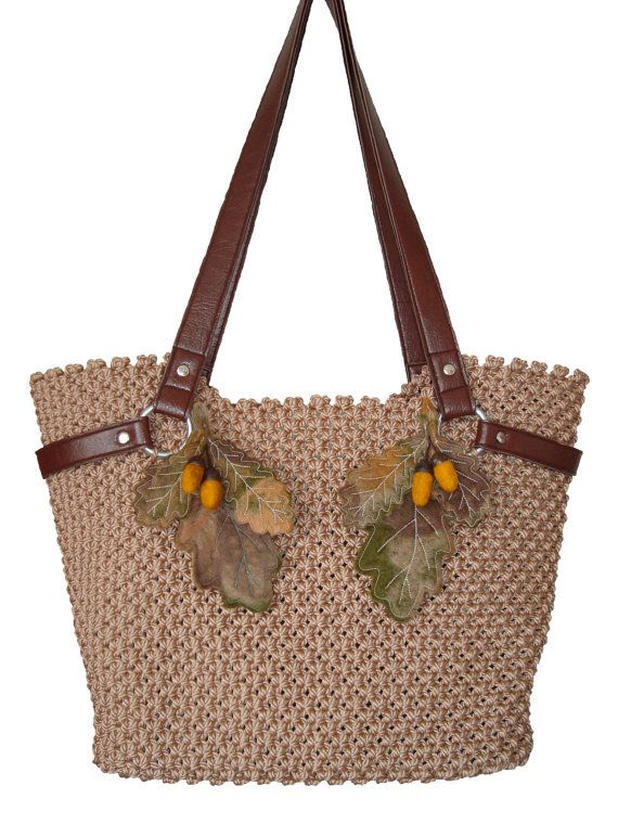 This beautiful brown bag is made in the art of macrame of strong .It's roomy and comfortable, and it can accomodate all the necessary things.Due to the strong rope and tight knots the bag keeps the shape and its very strong. The handles are made of eco-leather. The inside of the bag is placed with the material and closes with the zipper. The lief details are from the wool made by felting technique. Dimensions: 47 x 30 cm...bottom: 30x14 cm... handles lenght : 71cm