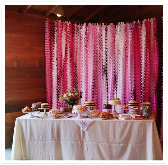 pink streamers as a dessert table backdrop