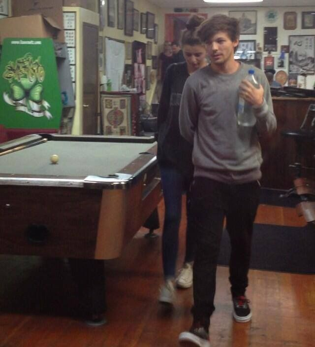 Louis Tomlinson and Eleanor Calder at a tattoo parlor