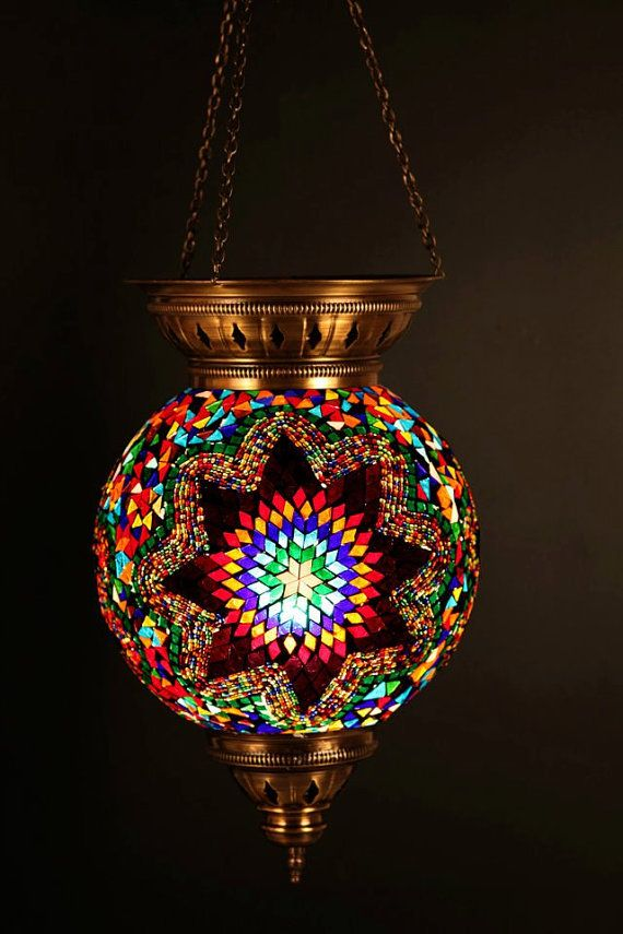 We love the vibrant spectrum hues and copper frame of this moroccan inspired hanging lantern the intricate glass mosaic and metalwork make it truly