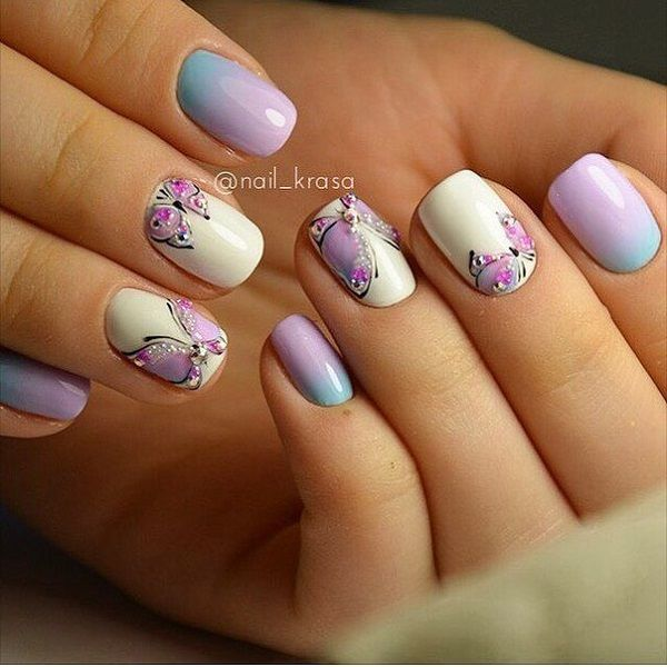 Beautiful gradient themed butterfly nail art design. The soft gradients of purple and blue make a beautiful compliment with the butterfly outlined in black polish with silver beads on top.