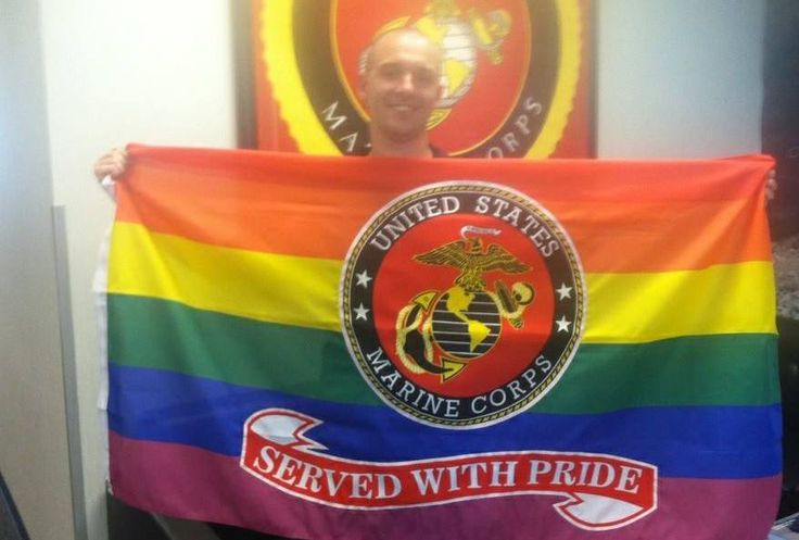 "A gay Marine received a rainbow falg on his last day of service  with the phrase ""Served with Pride"" stitched under the Marine Corps logo."
