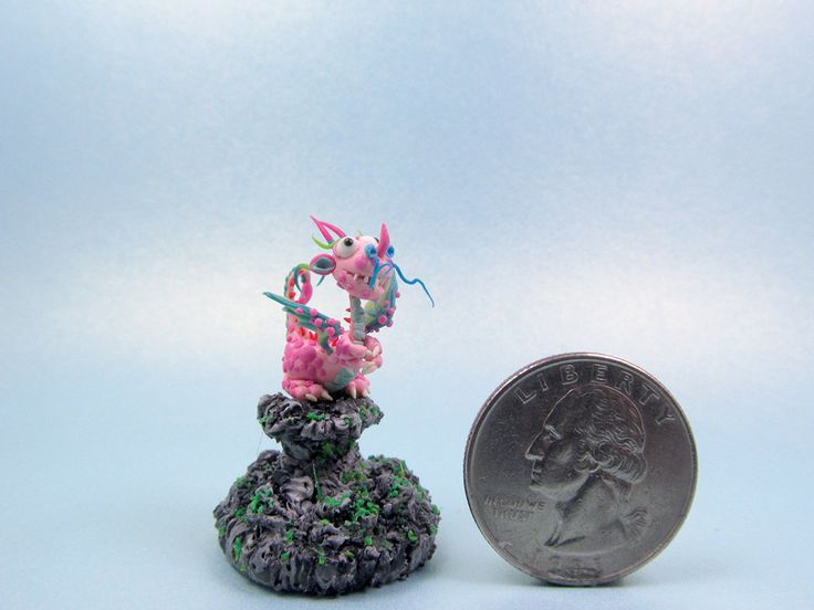Cute Mini Pink Dragon Clay No.6 (Polymer Clay) This cute mini pink dragon is waiting for his master, and it might be you. ^_^  This super cute collectible item is made of polymer clay which is waterproof. It comes on the rock base which is made from polymer clay. The dragon height is about 2 cm. The total height for the dragon and the glass dome is about 4.5 cm. This is handmade item. You will receive the item exactly as shown in the pictures. This is the one of the kind. The only one exist…