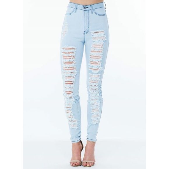 High waisted ripped light blue jeans  Bought this online but never got a chance to wear this outside. Has only been tried on. Jeans Skinny