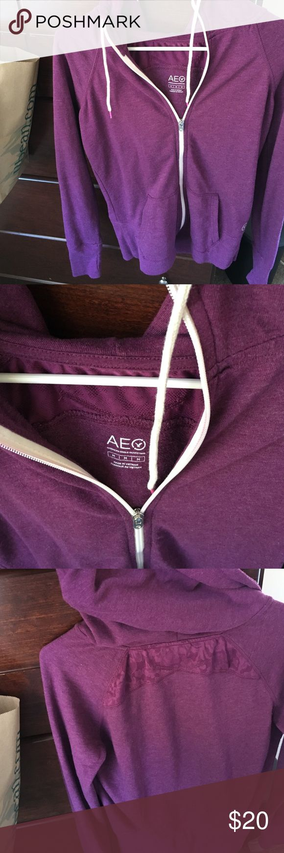 American Eagle sweatshirt size M Purple zip-up sweatshirt - size Medium - gently worn. No stains or damage! Could bundle with other American Eagle items listed! Has thumb holes in sleeves. American Eagle Outfitters Tops Sweatshirts & Hoodies