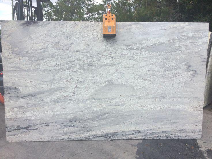 #Riverwhite premium #granite white and grey veining with small deep burgundy flecks. River White is a perfect #granitecountertops stone for light and dark #kitchencabinet and #kitchenisland.